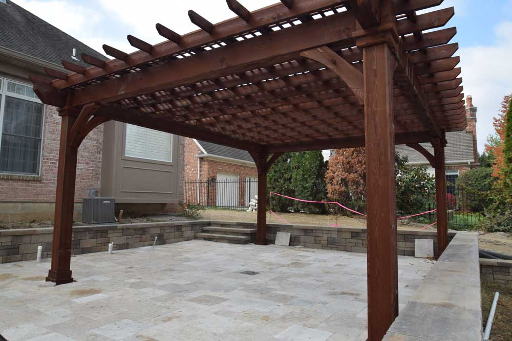 Stained Wood Pergola Over Pool Deck