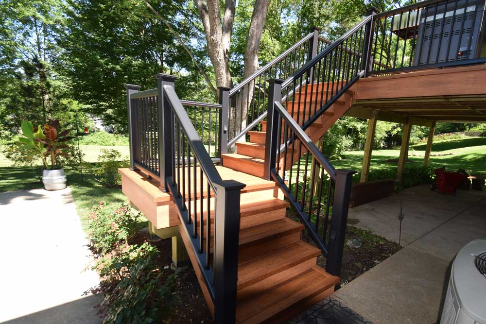 Zuri Pecan Trex Transcends Black Railing Stairs with Landing South County