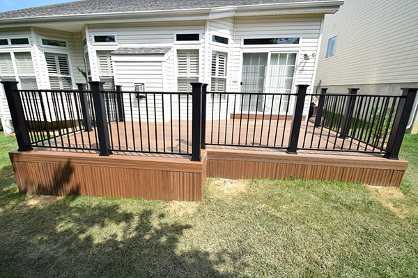 Envisions Spiced Teak Black Railing Black Posts St. Louis