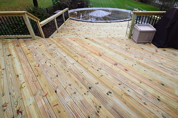 Wood Pine Deck Black Railing St. Louis