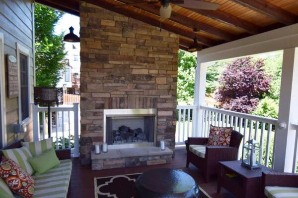 Outdoor Sun Room with Covered Deck and Fireplace